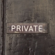 A sign that says private